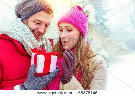 couple opening outdoors present