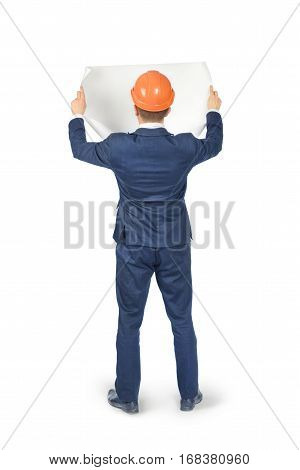 Man in suit and helmet with blueprints isolated on white background
