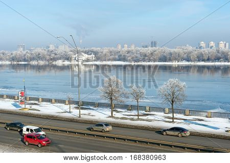 Traffic on embankment by Dnieper river on the Right bank in downtown Kiev, Ukraine