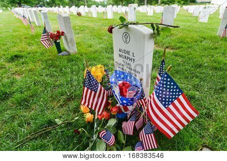 ARLINGTON, USA - MAY 28, 2013: Arlington National Cemetery with a flag next to each headstone during Memorial day - Washington DC United States