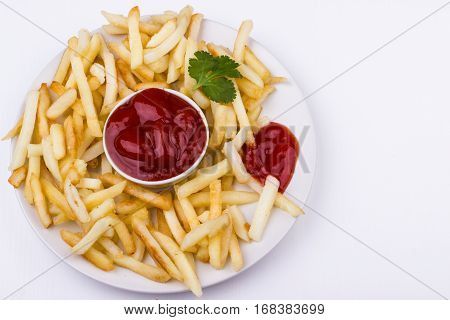 French Fries And Tomato Ketchup On A White Plate