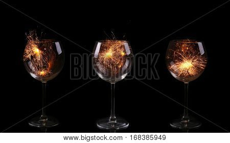Collage  Wine Glass With A Sparkler. In Anticipation Of New Year And Christmas