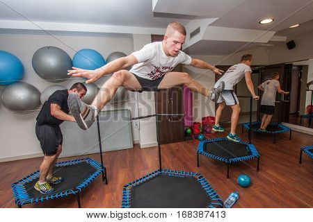 Otwock Poland - September 10 2016: Fitness. Young people jumping on small trampolines
