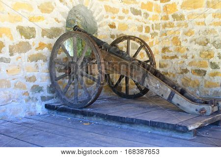 Old medieval artillery canon in the castle