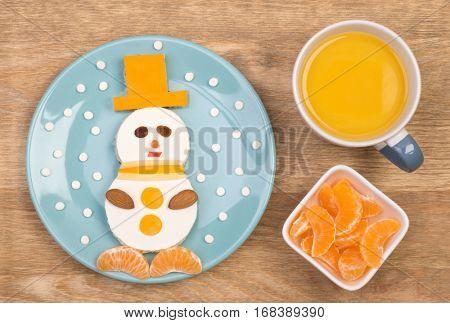 Funny sandwich for kids in shape of a snowman