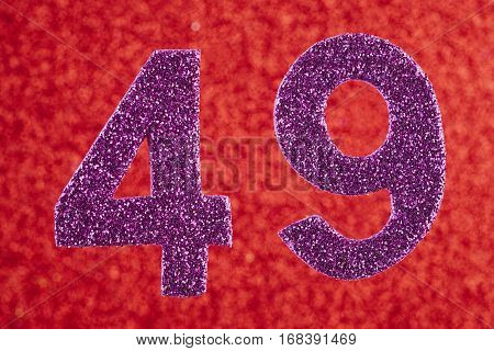 Number forty-nine purple color over a red background. Anniversary. Horizontal