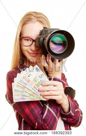 Successful woman as photographer with money and camera