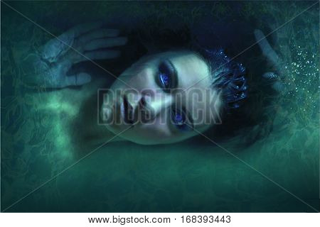 actress girl lies in green vodes volosamii flowing blue lips