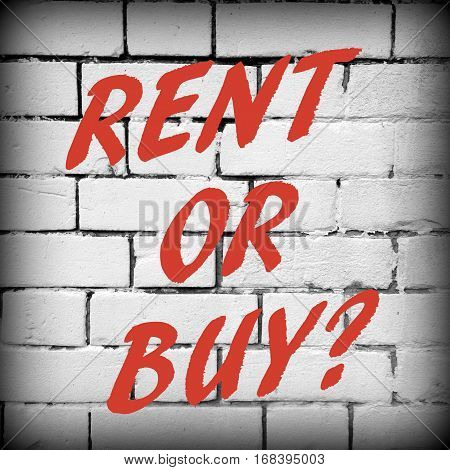 The words Rent or Buy in red text on a wall of black and white bricks