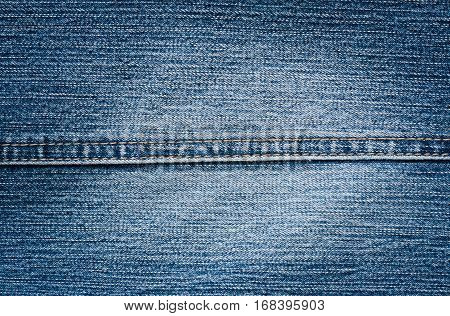 Blue Cloth Jeans Background With Seam Close Up.
