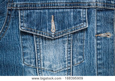 Pocket Of Blue Jeans Of Shirt With Seams Close Up.