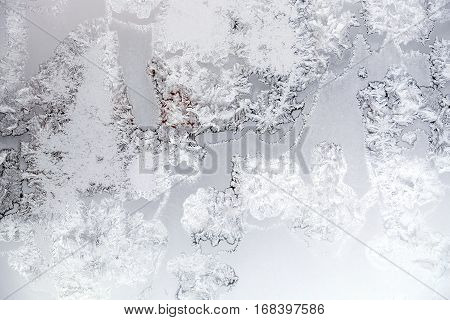 Beautiful hoarfrost tracery on frozen window a frosty day indoor horizontal view closeup