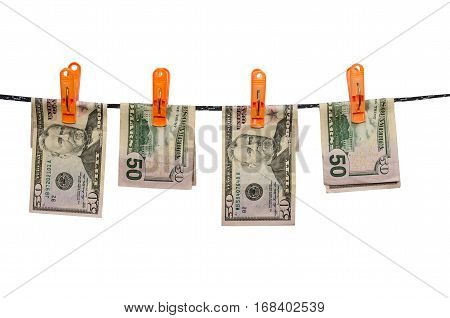 fifty us dollars are drying on cord isolated on white background