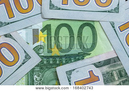 100 dollar and 100 euro banknotes close up