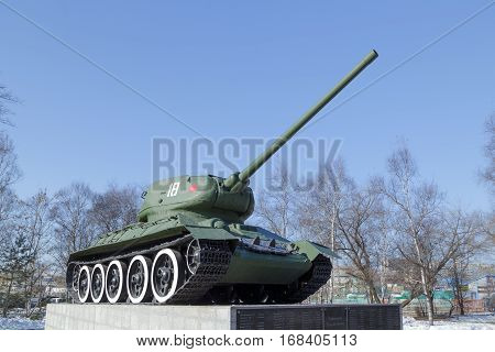 Vladivostok Russia - January 5th 2016: Vladivostok the Monument tank T-34 on a concrete pedestal as on a pedestal are established boards with surnames at war as a part of a tank column in 1943.
