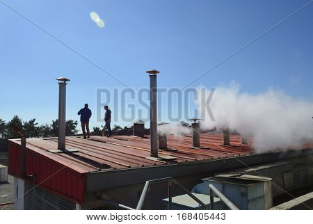 inspection of the roof of an industrial building