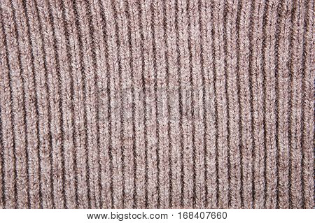 Brown structure of a knitted woolen fabric background