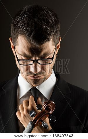 Violinist  playing with on dark background,
