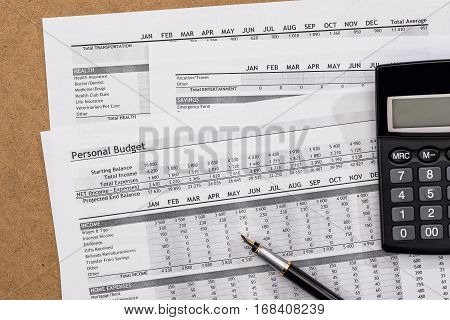 Personal Budget with pen and calculator. Finance Concept.
