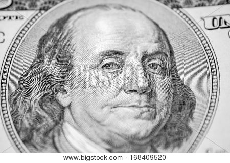 part of 100 dollars Benjamin Franklin close up