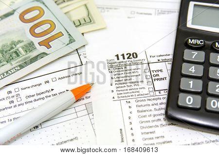 tax form 1120 dolar pen close up
