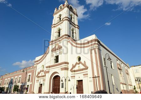 Camaguey Cuba - 11 January 2016: Iglesia de Nuestra Senora de la Merced church over Plaza de los Trabajadores in Camaguey Cuba