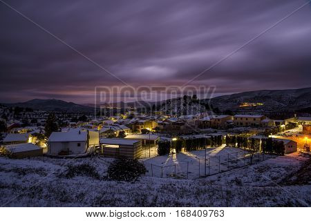 Nocturnal landscape of Cuatretondeta / Quatretondeta, Alicante, Spain after a historic snowfall.