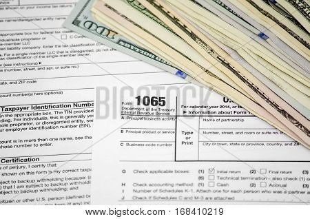 Tax forms 1065 with dollar close up