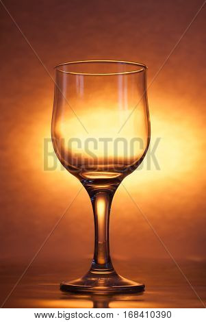 The Glass Is Empty On A Bright Yellow Background,