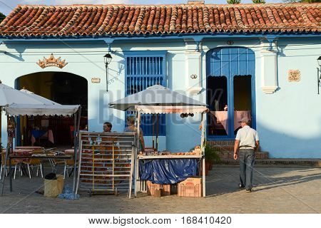 Camaguey Cuba - 11 January 2016: People walking in front of a restaurant in colonial house of Camaguey Cuba