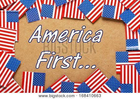 The words America First surrounded by a border of United States flags