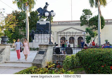 Camaguey Cuba - 11 January 2016: People walking in front of the Ignacio Agramonte monument at Ignacio Agramonte Park in Camaguey Cuba