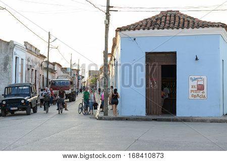 Camaguey Cuba - 11 January 2016: People walking on colonial streets of Camaguey on Cuba
