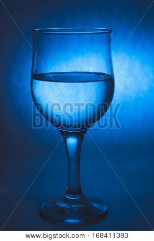 A Glass Of Water On A Cool Background,