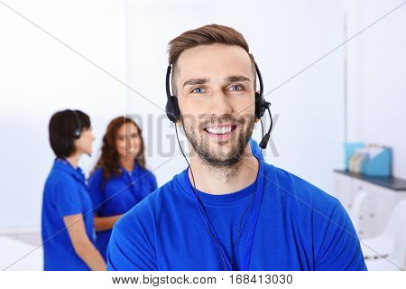 Young male technical support dispatcher working in office