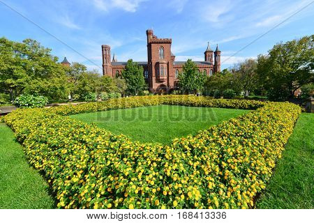 WASHINGTON DC, USA - OCTOBER 06, 2013: The Smithsonian Institution Building and the garden located near the National Mall in Washington, D.C. and designed by architect James Renwick, Jr.