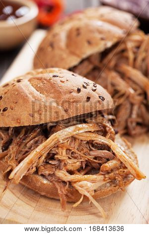 Pulled pork sandwich in whole grain burger bun