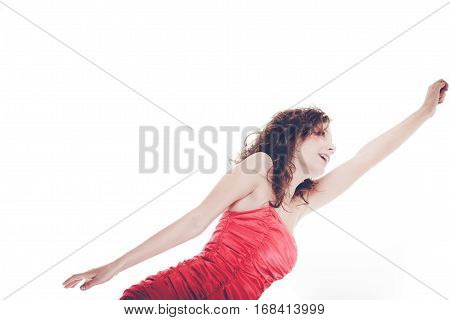 Happy and energetic woman reach with hand. Young female wear red dress.