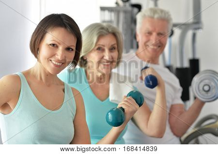 Portrait of a family doing exercises, sport concept