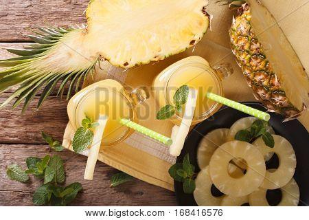 Homemade Pineapple Juice In A Glass Jar Closeup. Horizontal Top View