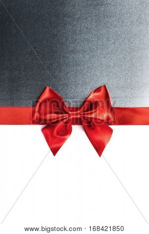 Red gift ribbon bow and metal isolated on white background
