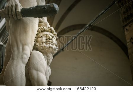 Statue with a club in Florence Italy