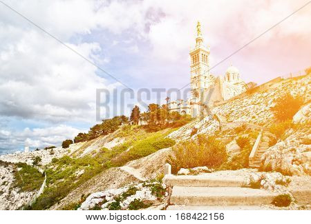 Notre-Dame de la Garde (literally Our Lady of the Guard) is a basilica in Marseille France. This ornate Neo-Byzantine church is situated at the highest natural point in Marseille.