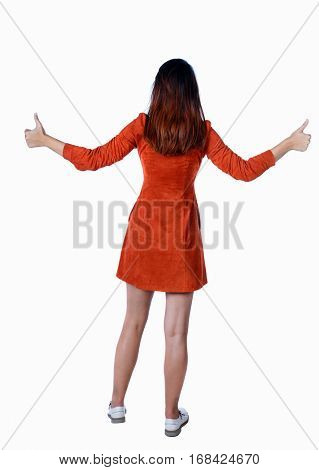 Back view of  woman thumbs up. Rear view people collection. backside view of person. Isolated over white background.  The girl in a red dress shows two hands thumbs up.
