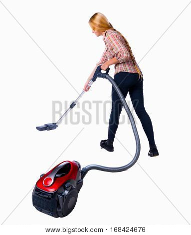 Rear view of a woman with a vacuum cleaner. She is busy cleaning. Rear view people collection.  backside view of person.  vacuum cleaner in the foreground and a woman in the background.