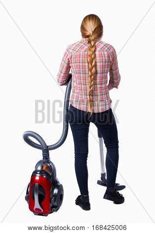 Rear view of a woman with a vacuum cleaner. She is busy cleaning. Rear view people collection.  backside view of person.  Isolated over white background. Girl in plaid shirt with red vacuum cleaner.