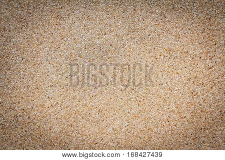 Small sand stone of sand wall texture or sand wall background. Natural brown sand stone for design with copy space for text or image. Dark edged.