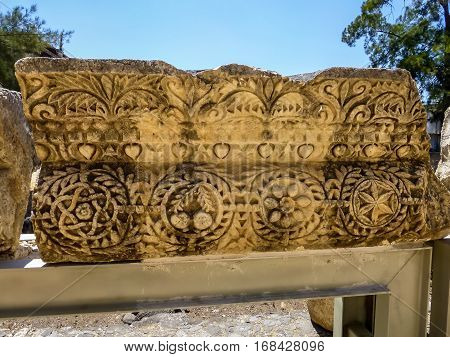 The stone block with carvings carved stone block in ancient Capernaum archaeological site in Galilee Israel