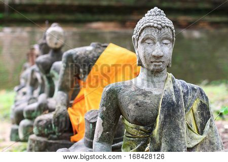 Buddha statue in Wat Umong Chiang Mai Thailand. Old ruined Buddha statue in the ancient Buddha temple. Travel Thai temple in northern Thailand.