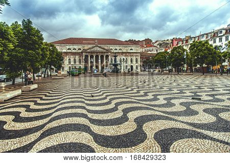 LISBON PORTUGAL - SEPTEMBER 27 2013: Rossio Square is the popular name of the Pedro IV Square in Lisbon Portugal. It has been one of its main squares since the Middle Ages